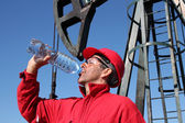 Thirsty Oil Industry Worker. — Stock Photo