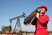 The Oilfield Worker At Well Pump Jack Site. — Stock Photo