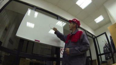 Engineer With Whiteboard — Stockvideo