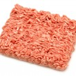 Isolated pease of raw minced beef on white background — Stock Photo
