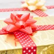 Christmas gift boxes with ribbons — Stock Photo