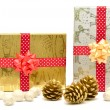 Gift boxes with red and golden ribbons — Stock Photo