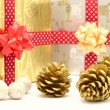 Gift boxes with red and golden ribbons — Stockfoto