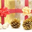 Gift boxes with red and golden ribbons - Stock Photo
