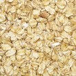 Dry rolled oats background — Stock Photo