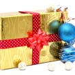 Golden gift box with red ribbon and christmas balls — Stock Photo