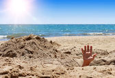 Humans hand on the sandy beach — Stock Photo
