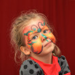 Little girl painted face as butterfly — Stock Photo