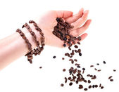 Bracelet from coffee beans on a female hand — Stock Photo