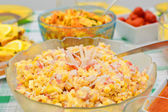 Salad with crab sticks and corn — Stock Photo