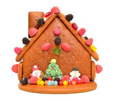 Decorated gingerbread house — Stock Photo