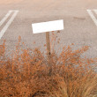 Empty nameplate on parking — Stock Photo