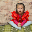 Stock Photo: Little girl singing with headphones