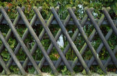 Dark decorative wooden fence — Stock Photo