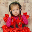 Little girl with headphones — Foto de Stock