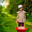 Girl with wheelbarrow — Stock Photo