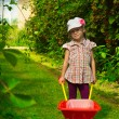 Girl with wheelbarrow — ストック写真
