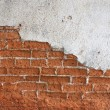 Old red brick wall disintegrated — Stock Photo