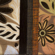 Different colors Textile flax fabric wickerwork texture with drawing flowers — Stock Photo #16646901