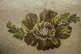 Tyg i olika färger med mönster av blommor — Stockfoto