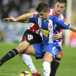 Foto Stock: Marquez(L) of Espanyol fight with Gurpegi(R)