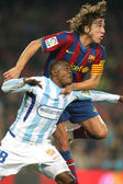 Obinna(L) of Malaga and Puyol(R) of Barcelona — Foto Stock