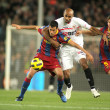 Busquets(L) of Barcelona fight with Kanoute(R) — Stock Photo