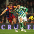 Foto Stock: Puyol of Barcelonfight with Molinof Betis