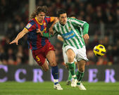 Puyol of Barcelona fight with Molina of Betis — Stock Photo
