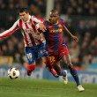 Reyes(L) of Atletico fight with Abidal(R) of Barcelona — Stock Photo