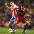 Lopez(L) of Atletico fight with Alves(R) of Barcelona - Stock Photo