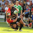Toulons's Christian Loamanu is tackled by Perpignan's player — Foto de Stock
