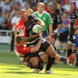 Toulons's Christian Loamanu is tackled by Perpignan's player — Stok fotoğraf