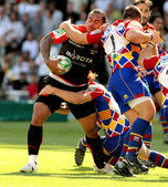 Toulons's Christian Loamanu is tackled by Perpignan's player — Zdjęcie stockowe