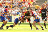 Toulons's Gabiriele Lovobalavu is tackled by Perpignan's players — Stock Photo
