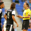 Demichelis and Welington of Malaga discuss with the referee Delgado Ferreiro — Stock Photo