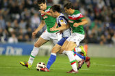 Verdu(C) of Espanyol fight with Ekiza(R) and Javi Martinez(L) of Bilbao — Stock Photo