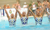 Japan synchro swimmers team in a Free Team Rutine — Stock Photo