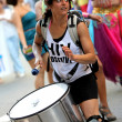 Drummer playing while parades during the annual Barcelona Gay and Lesbian Pride Festival — Stock Photo