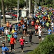 Runners on the popular race of the Olympic Village - Stock Photo