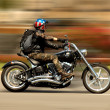 Постер, плакат: Harley Davidson Motorcycle drives through the streets of Barcelona