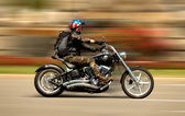 Harley-Davidson Motorcycle drives through the streets of Barcelona — Stock Photo