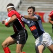 Постер, плакат: Adrian Baltag L of Moldavia is tackled by Nikolay Goroshilov R of Russia