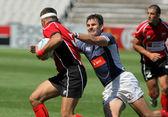 Adrian Baltag(L) of Moldavia is tackled by Nikolay Goroshilov(R) of Russia — ストック写真