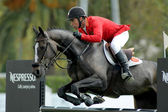 Jesus Garmendia of Spain in action rides horse Perle Condeenne — Stock Photo