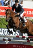 Eugenio Corell in action rides horse Apolo 817 — Stock Photo