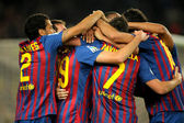 Group of FC Barcelona players celebrating goal — Stock Photo