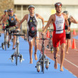 Triathletes on transition zone of Barcelona — Stock Photo #19133637