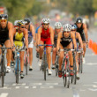 Triathletes on Bike event — Stock Photo