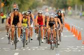 Triathletes on Bike event — Stock Photo
